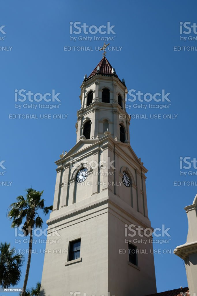 Close up of Bell tower of the Cathedral Basilica of St. Augustine in St Augustine, Florida. Historic church,stucco cladding and terra cotta tiled roof, Spanish Mission meets Neoclassical architecture. stock photo