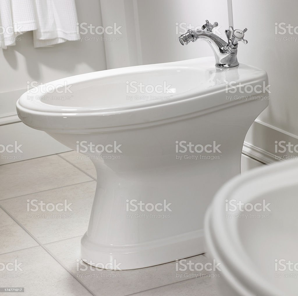 Close up of bidet in bathroom stock photo