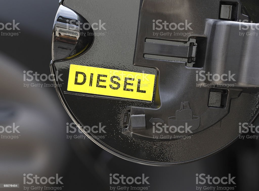 Close up of black diesel cap with yellow diesel sign stock photo