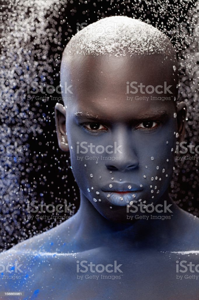 close up of black male model with blue make-up stock photo