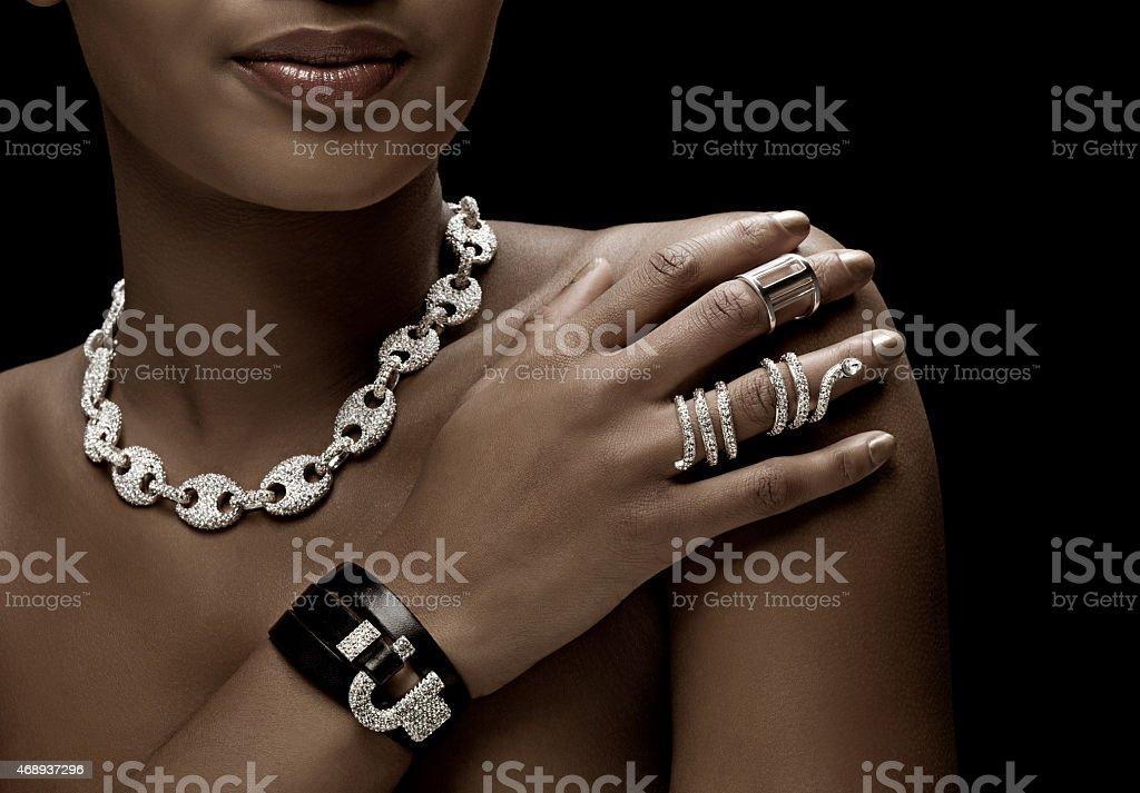 close up of black woman wearing luxury silver jewellery stock photo