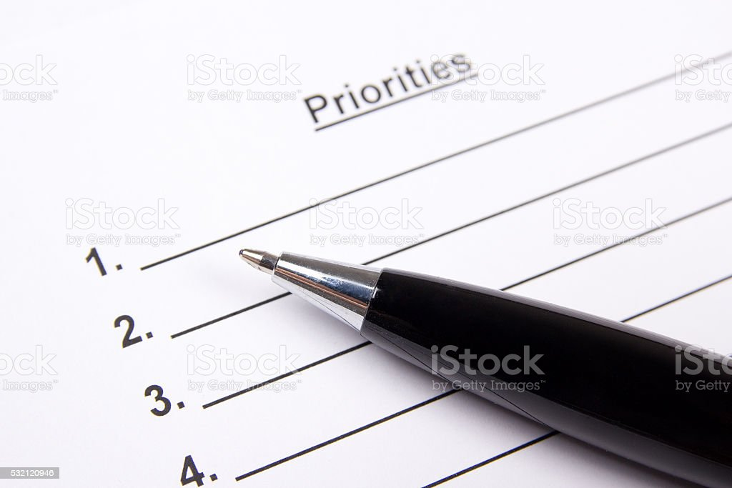 close up of blank list of priorities and pen stock photo