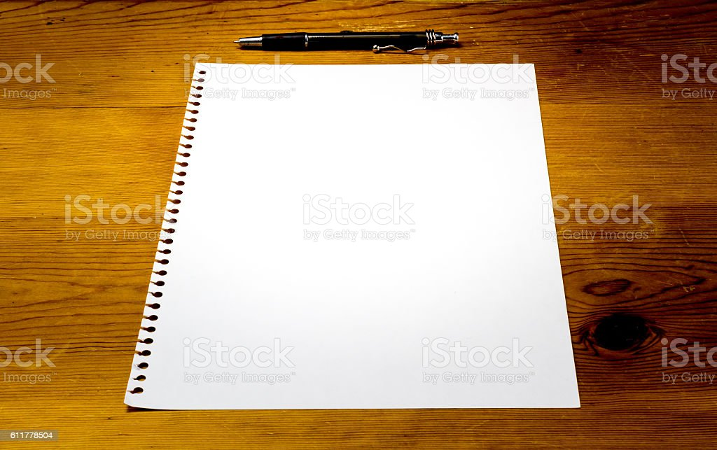 Close up of blank paper on table with pen stock photo
