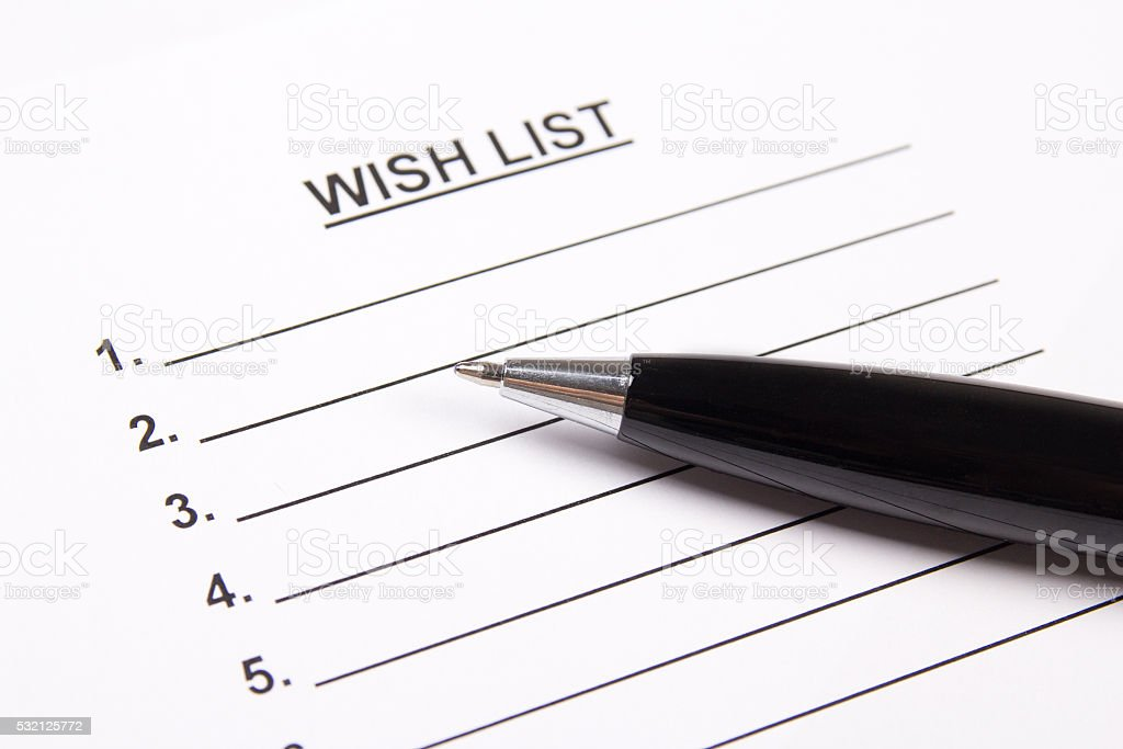 close up of blank wish list and pen stock photo