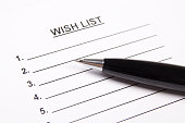 close up of blank wish list and pen