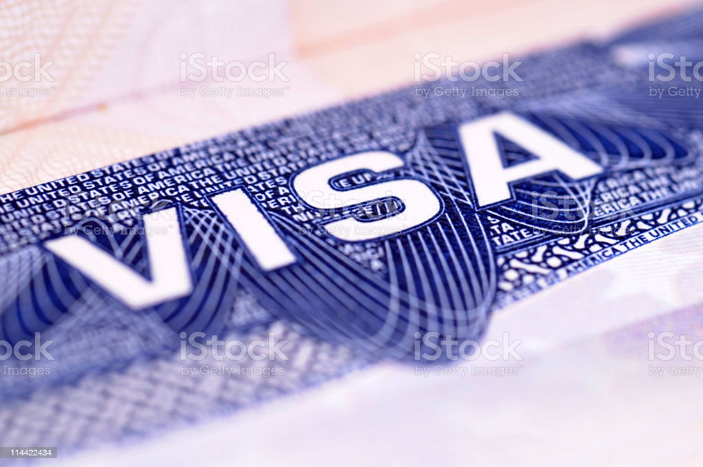 Close up of blue and white letters on American Visa royalty-free stock photo