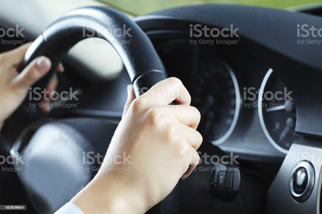 Close up of body part - hands on the wheel. royalty-free stock photo