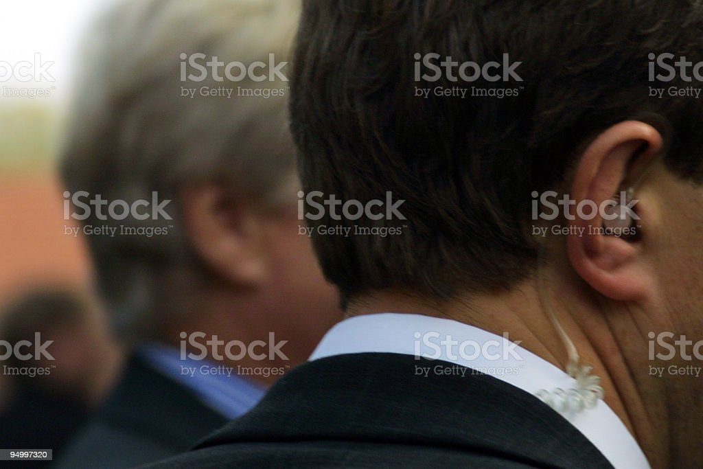 close up of bodyguards in action with Hands-free Device royalty-free stock photo