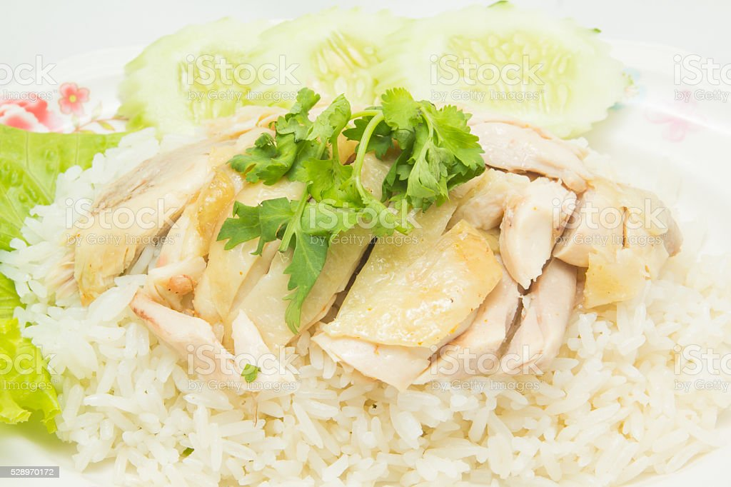 Close up of boned, sliced Hainan-style chicken with marinated rice stock photo