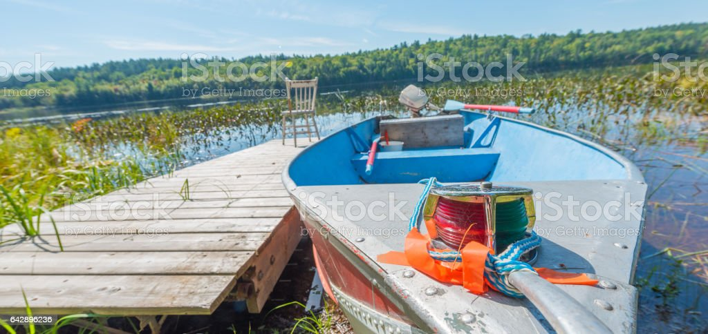 Close up of bow of a well-used, small aluminum boat. stock photo