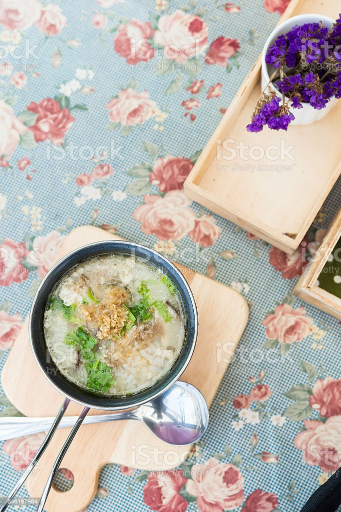 Close up of breakfast rice soup on table stock photo