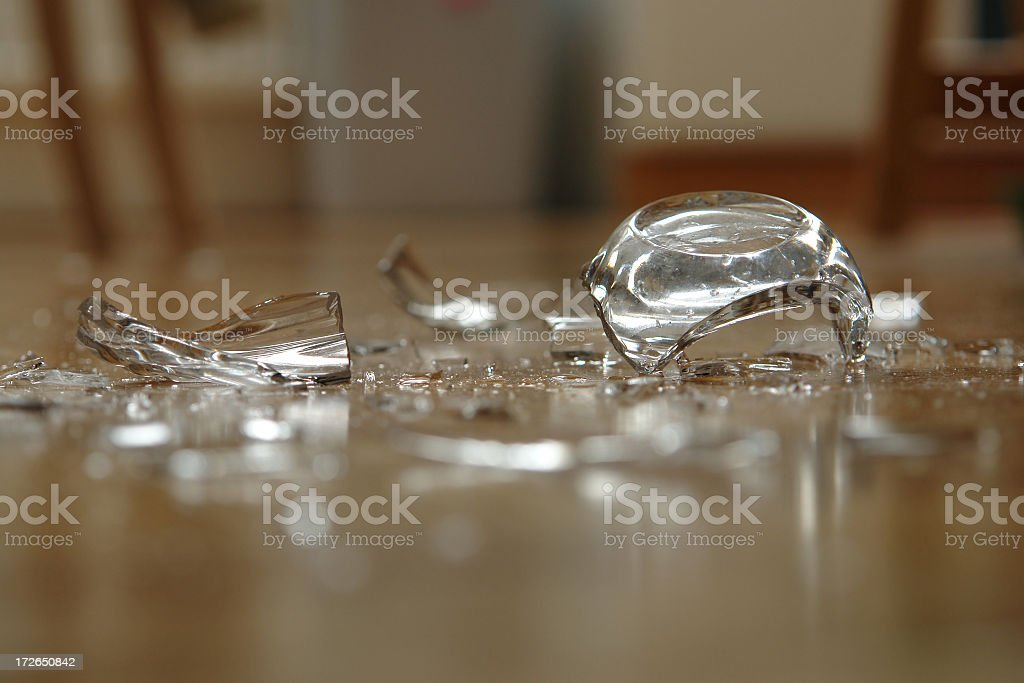 Close up of broken glass on floor stock photo
