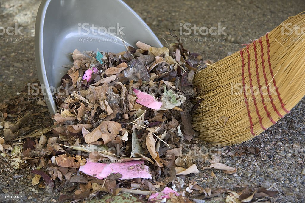 Close up of Broom Sweeping Leaves into Dustpan stock photo