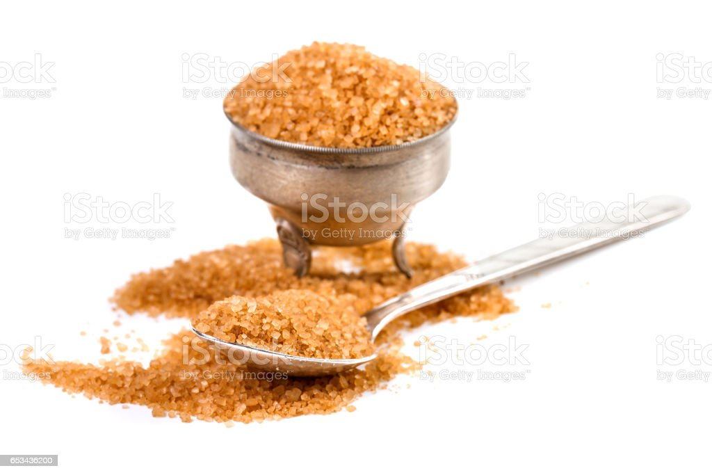 close up of brown sugar on white background stock photo