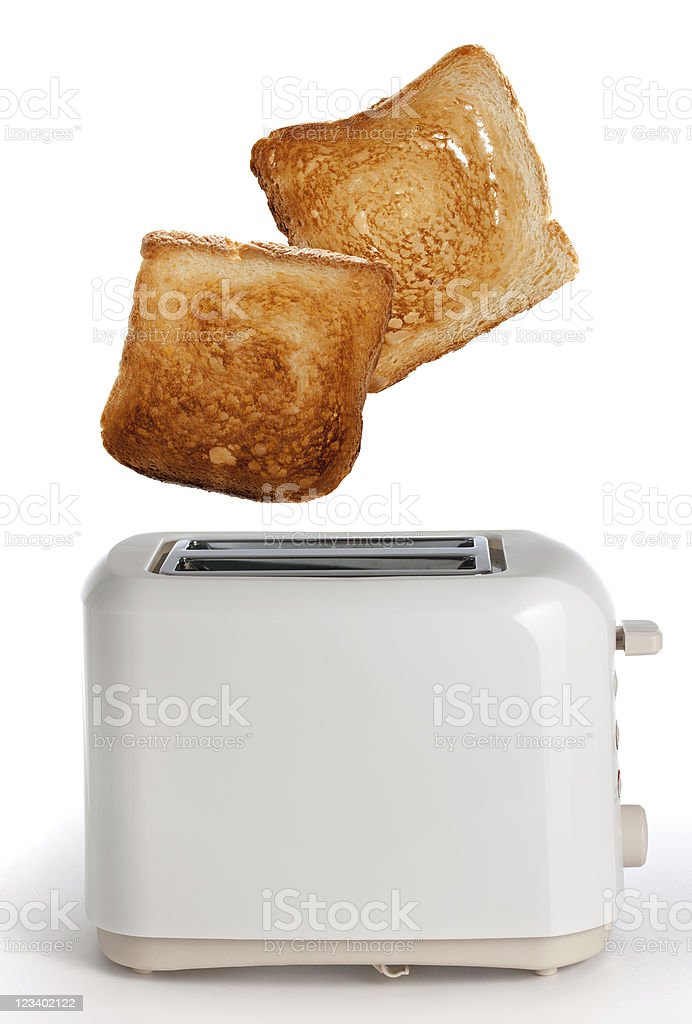 Close up of browned toast popping out of white toaster stock photo