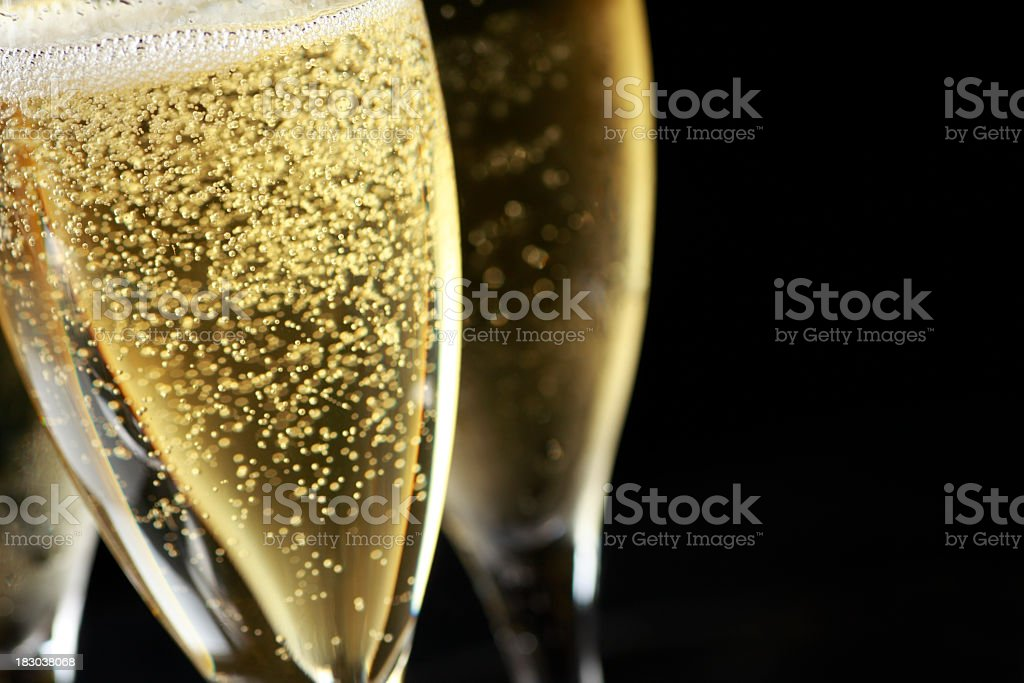 Close up of bubbles in freshly poured Champagne glass stock photo