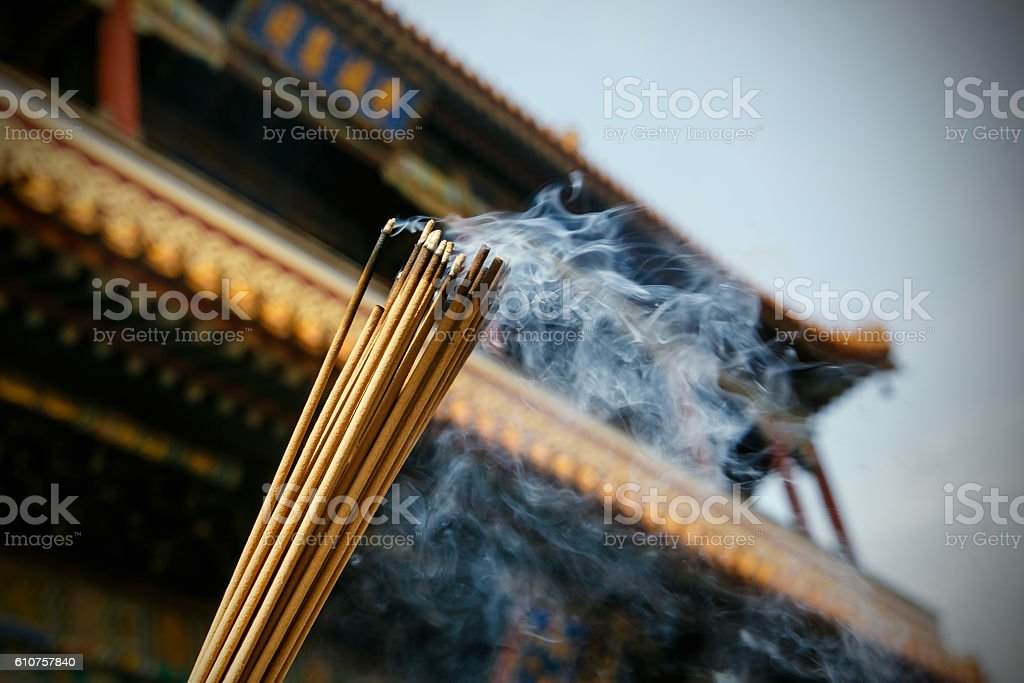 Close up of burning incense sticks in a pagoda stock photo