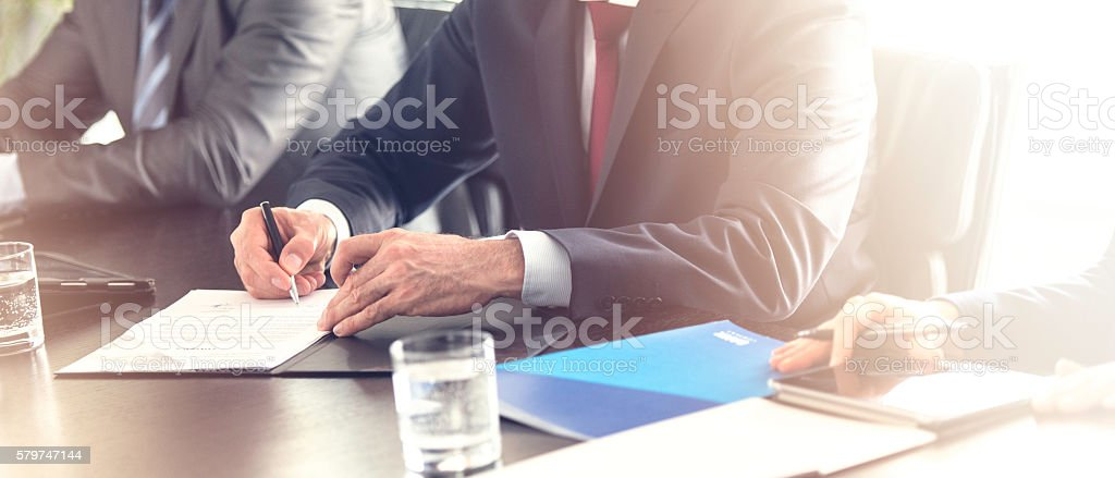 Close up of businesman signing a contract stock photo