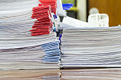 Close up of business documents stack on desk , report paper