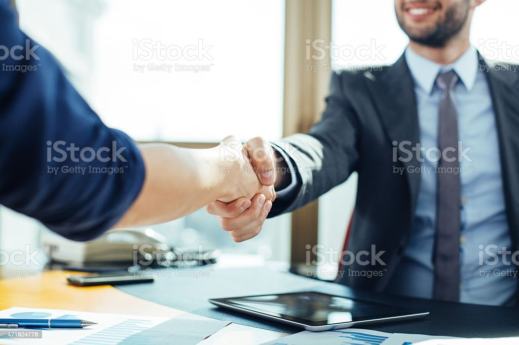 Close up of business handshake in the office stock photo