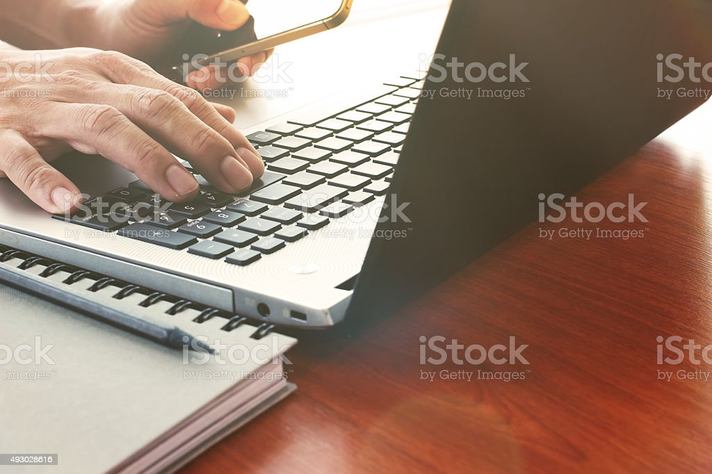 Close up of business man hand working on laptop computer stock photo