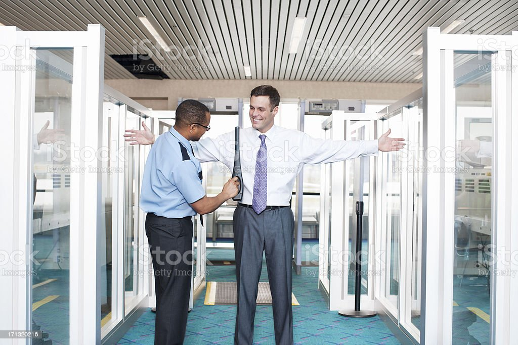 Close Up of Businessman Going Through Airport Security stock photo