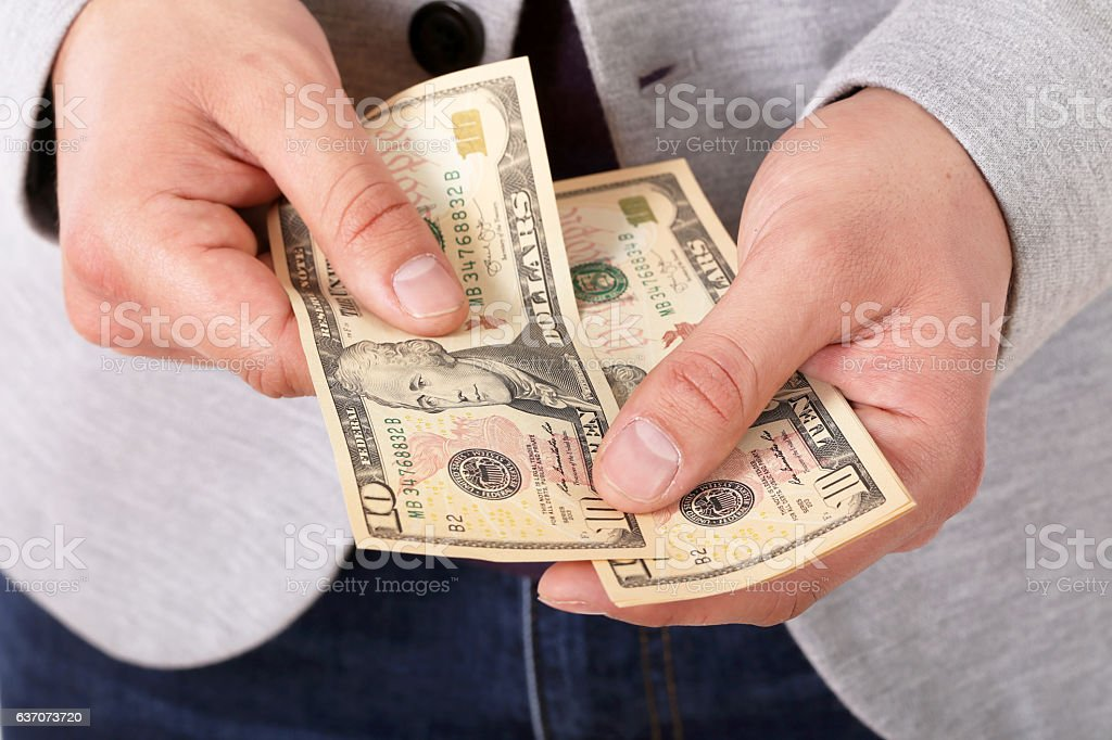 Close up of businessman hands counting dollar banknotes stock photo