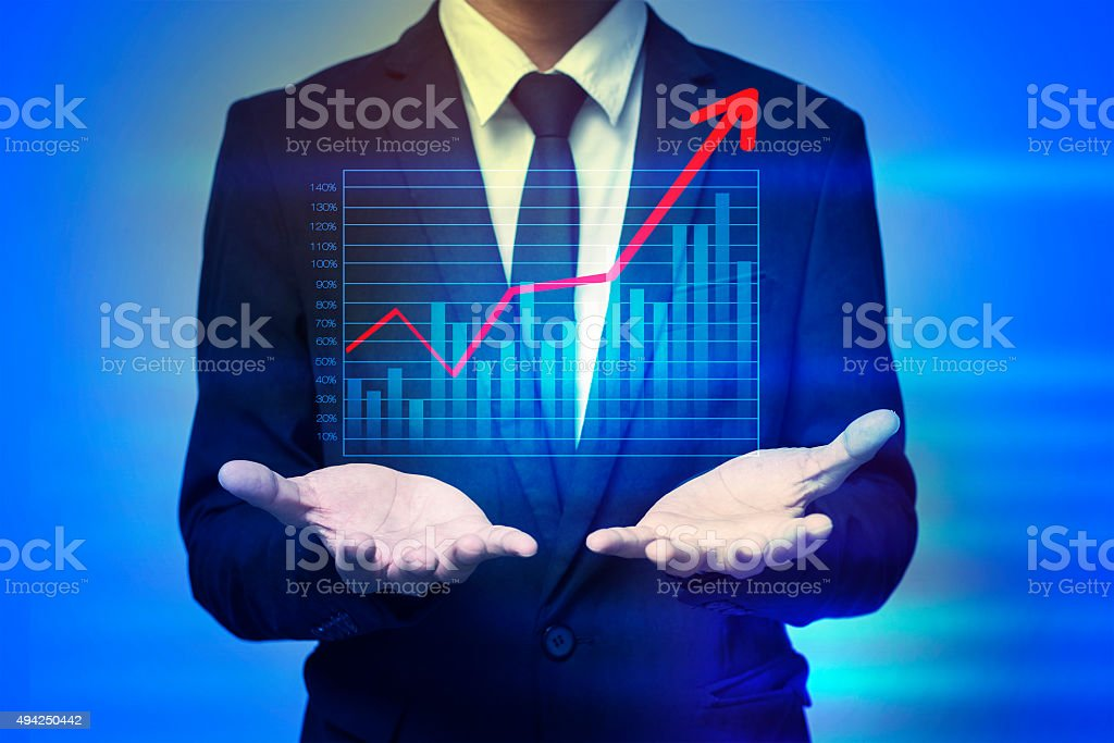 Close up of businessman holding graph in palms stock photo