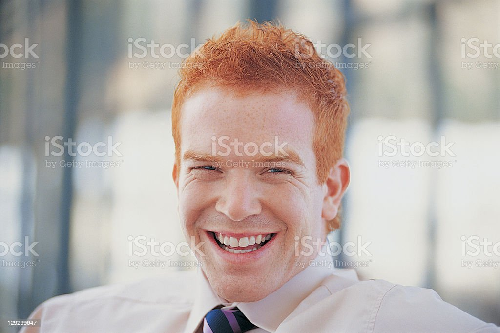 Close up of businessman laughing stock photo