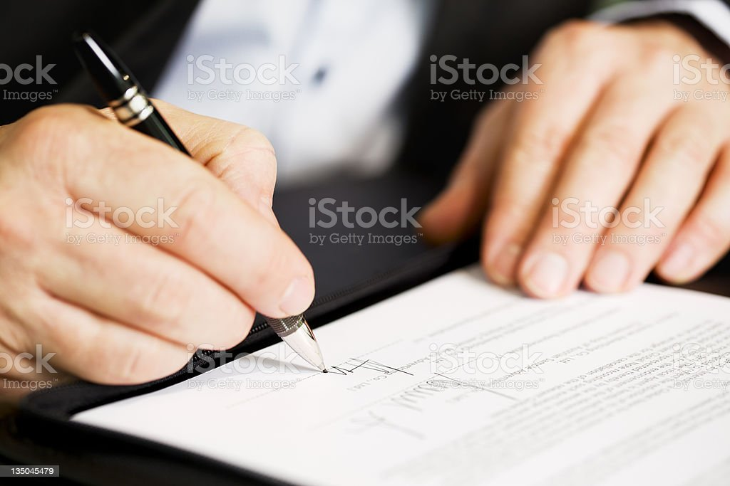 Close up of businessman signing a contract. royalty-free stock photo