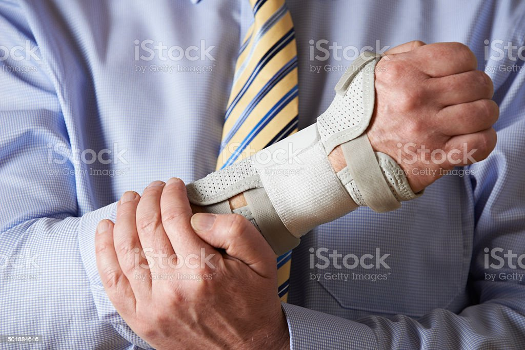 Close Up Of Businessman Suffering With Repetitive Strain Injury stock photo