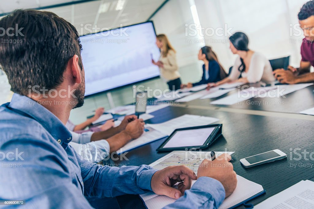 Close up of businessman taking notes on a seminar stock photo