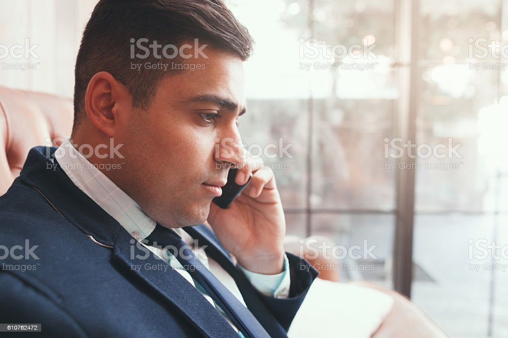 Close up of businessman talking on phone stock photo