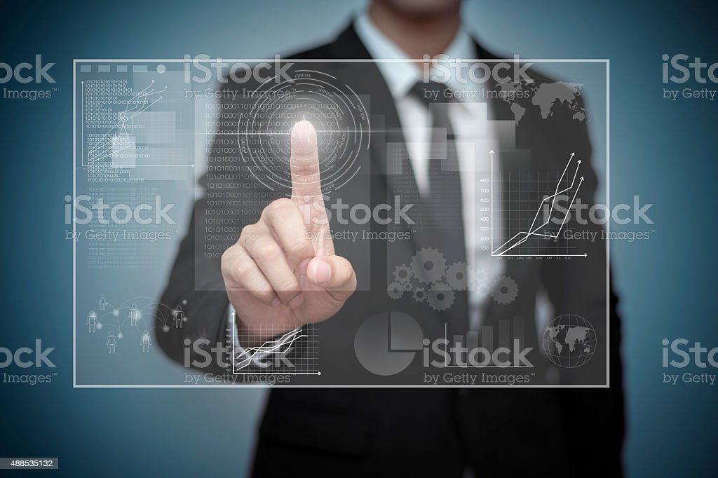 Close up of businessman touching digital screen with finger stock photo