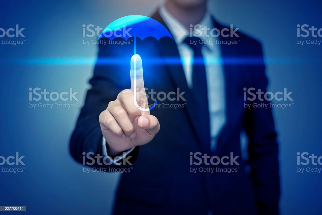 Close up of businessman touching umbrella icon, business securit stock photo