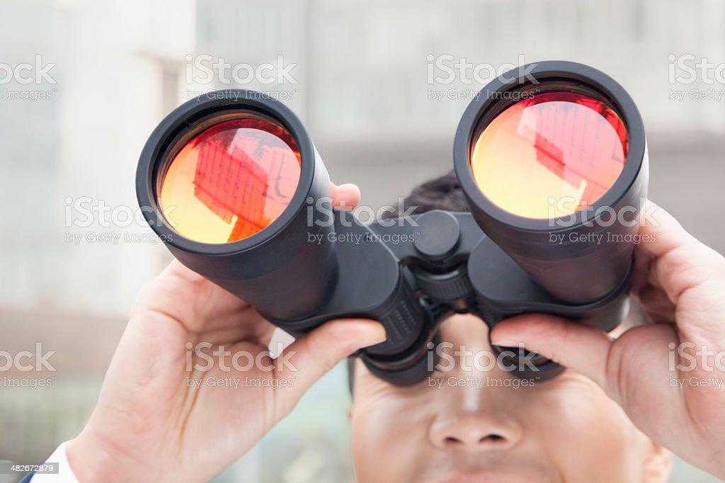 Close Up of Businessman Using Binoculars, Reflection stock photo