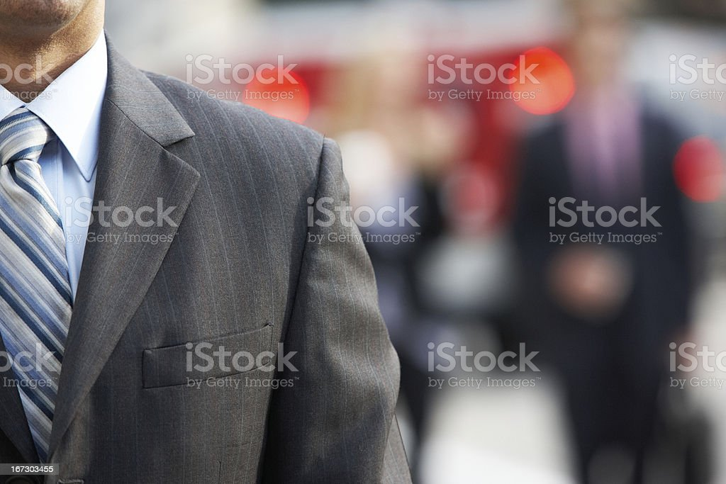 Close Up Of Businessman Walking Along City Street royalty-free stock photo