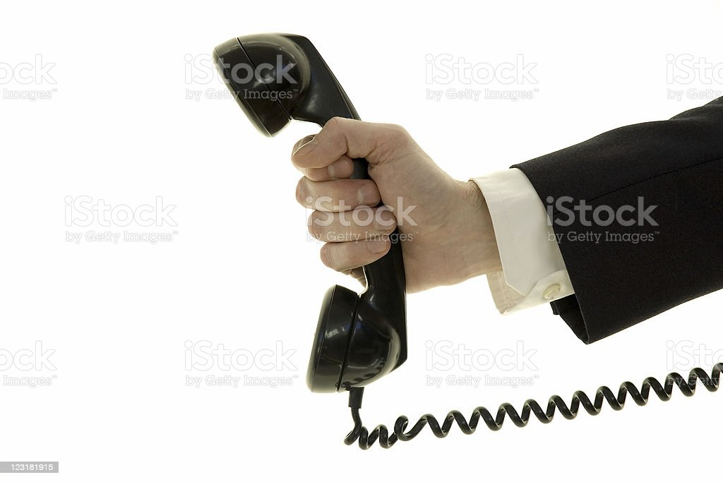 Close up of businessman's hand holding corded phone royalty-free stock photo