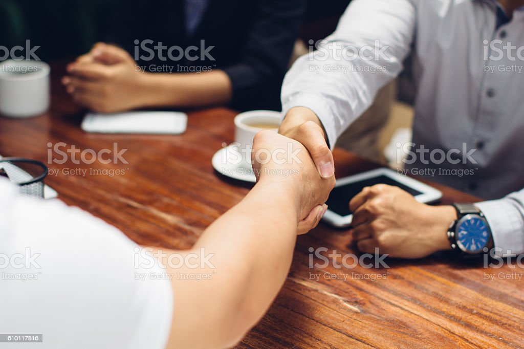 Close up of businessmen shaking hands stock photo