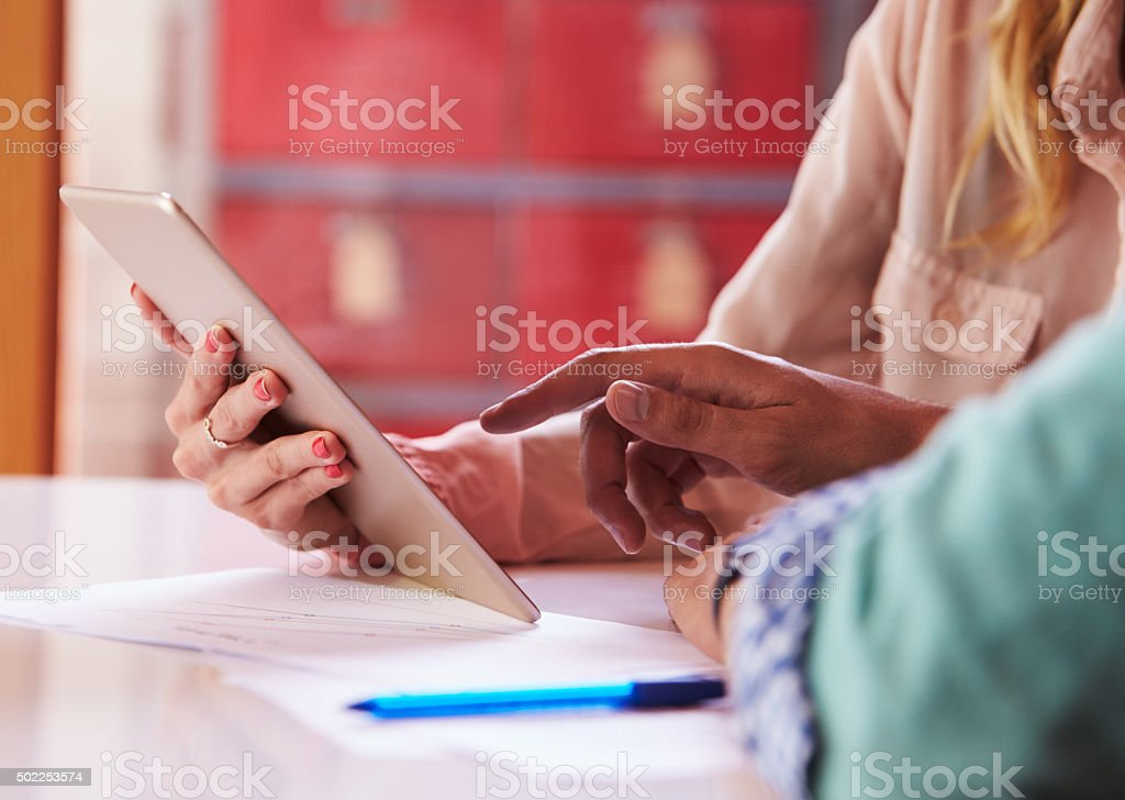 Close Up Of Businesspeople With Digital Tablet In Meeting stock photo