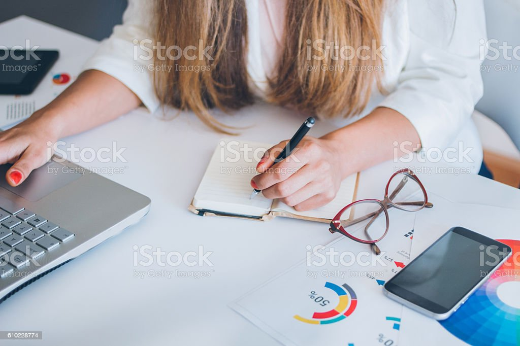 Close up of busy female hand typing on keyboard stock photo