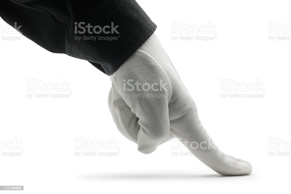 Close up of butler using finger to inspect for dirt royalty-free stock photo