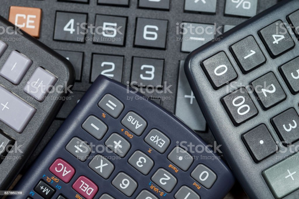 Close up of calculator keypads bunched together stock photo