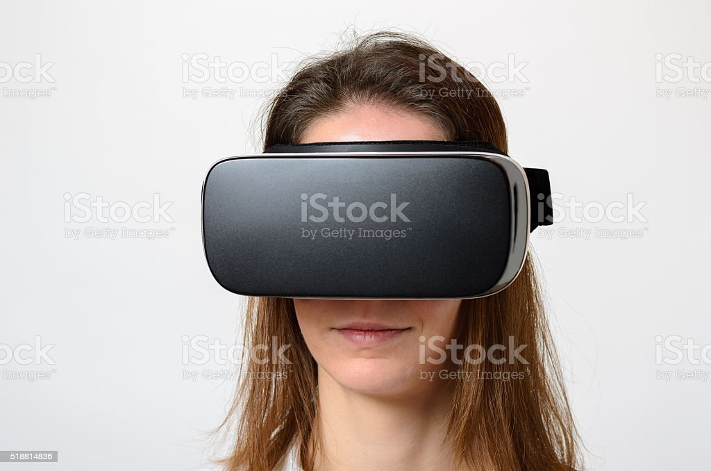 Close up of calm woman wearing virtual 3d device stock photo