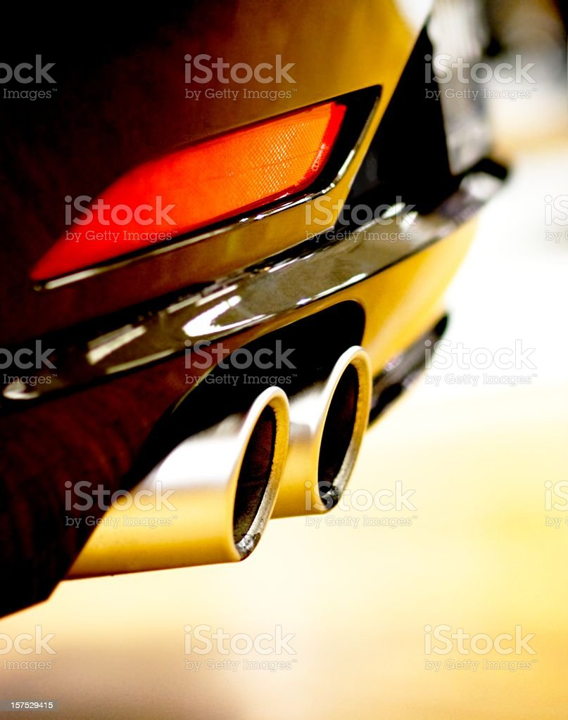 Close Up of Car Exhaust and Red Tail Light stock photo