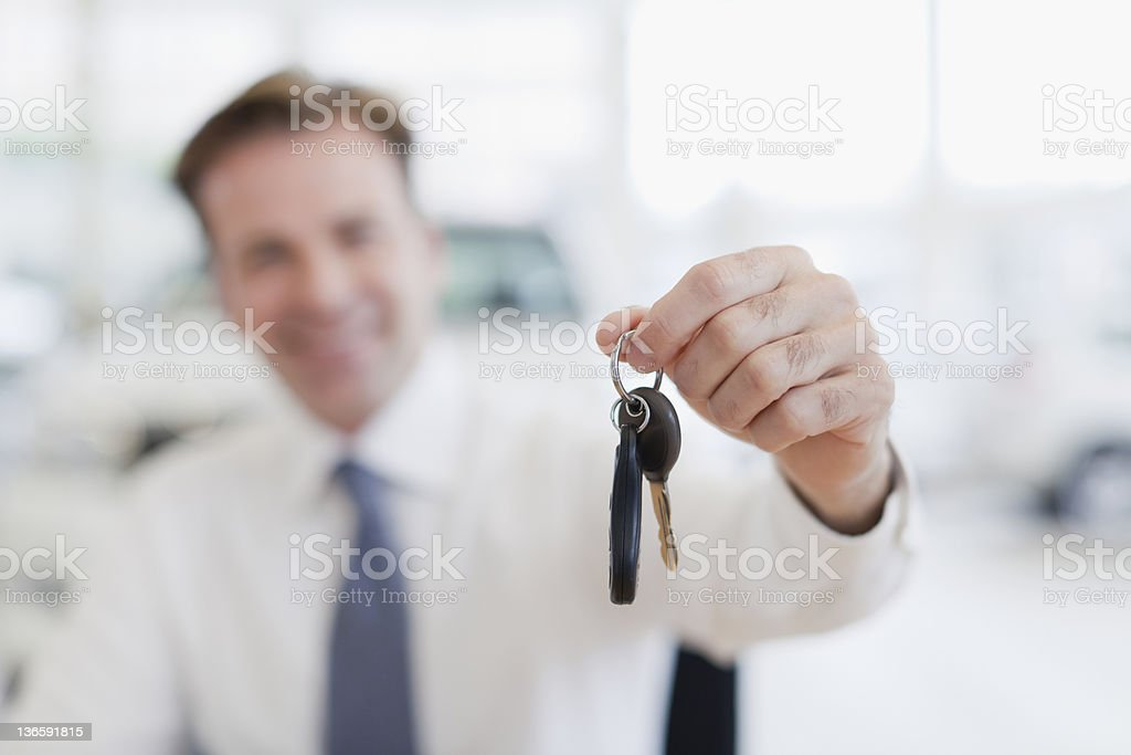 Close up of car salesman holding keys stock photo