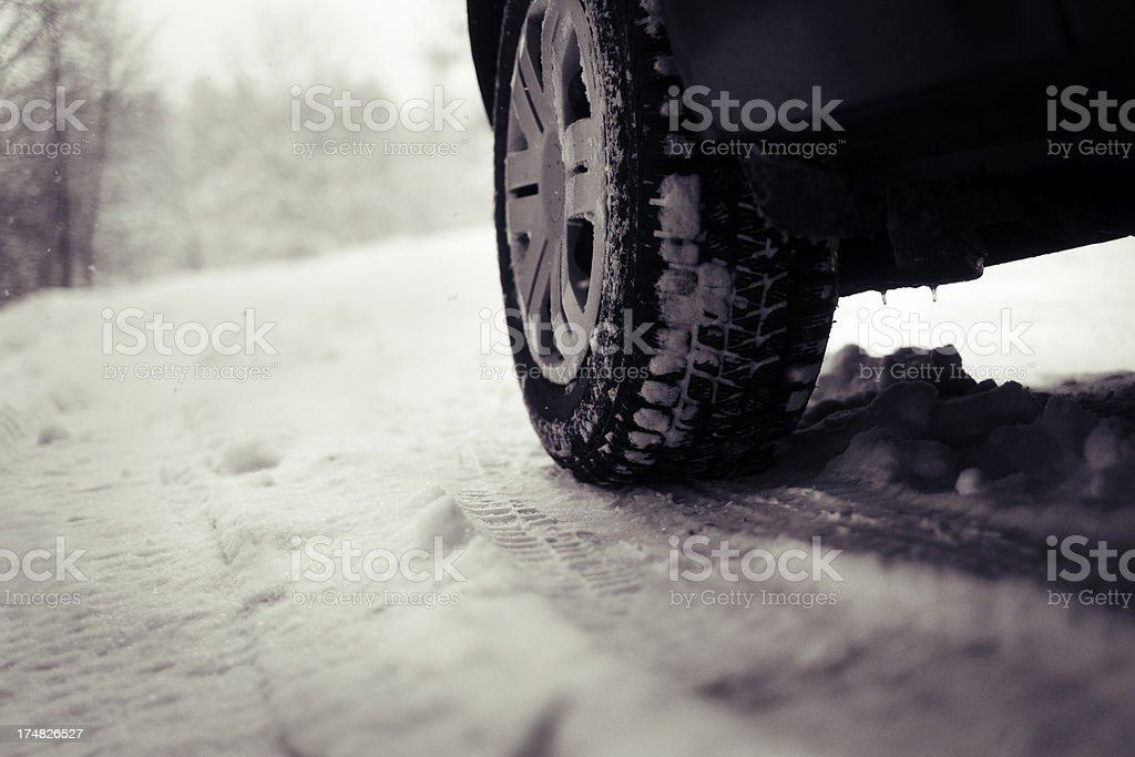 Close up of car winter tire in snow royalty-free stock photo
