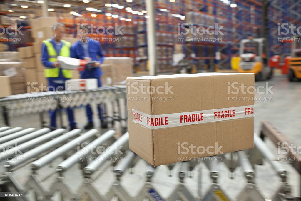 Close up of cardboard box on conveyor belt stock photo