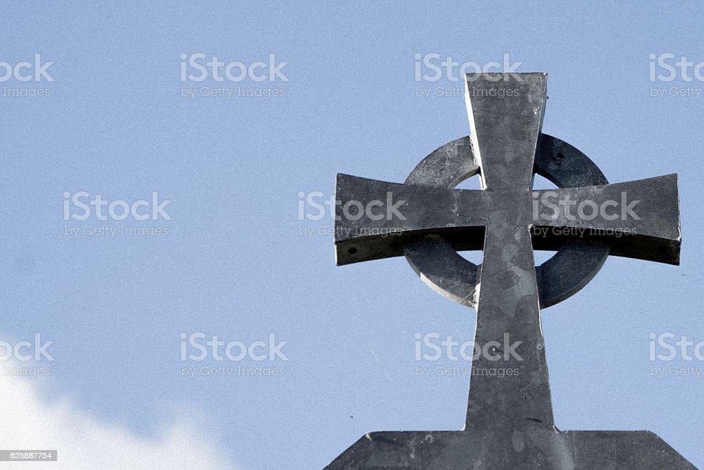 Close up of Celtic cross - grey metal, blue sky stock photo
