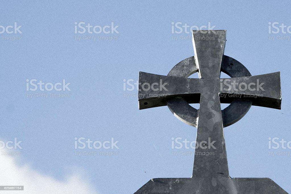 Close up of Celtic cross - grey metal, blue sky stock photo